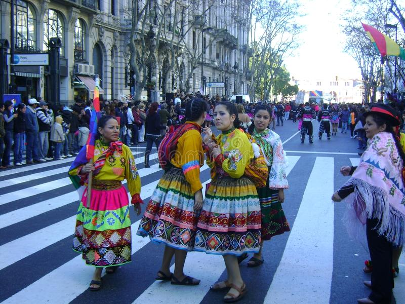 Bolivians dancing in traditional dress on streets royalty free stock photo