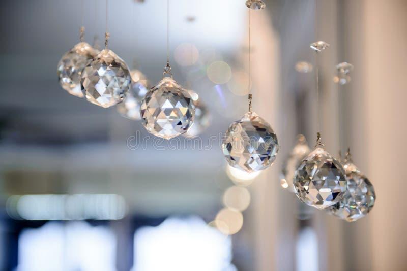 Bollar är exponeringsglas fasetterat hänga royaltyfri foto