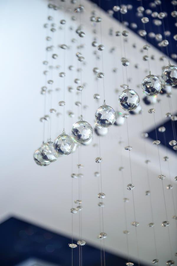 Bollar är exponeringsglas fasetterat hänga royaltyfri fotografi