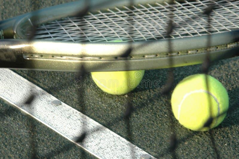 bollar förtjänar racqueten royaltyfri fotografi