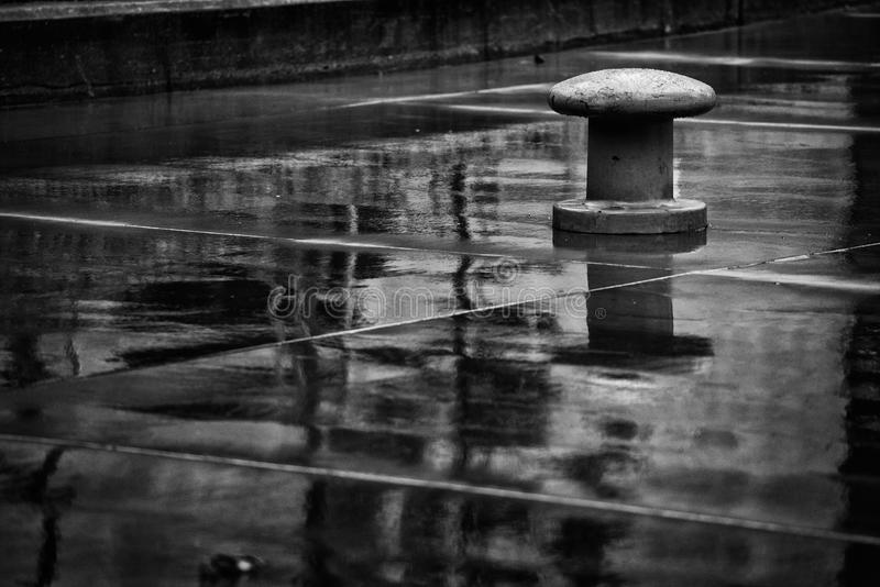 Bollard. On the quay a rainy day stock images