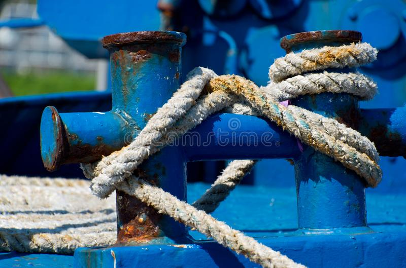 Bollards and cleats with ropes. At port of sassnitz, ruegen, germany stock photography