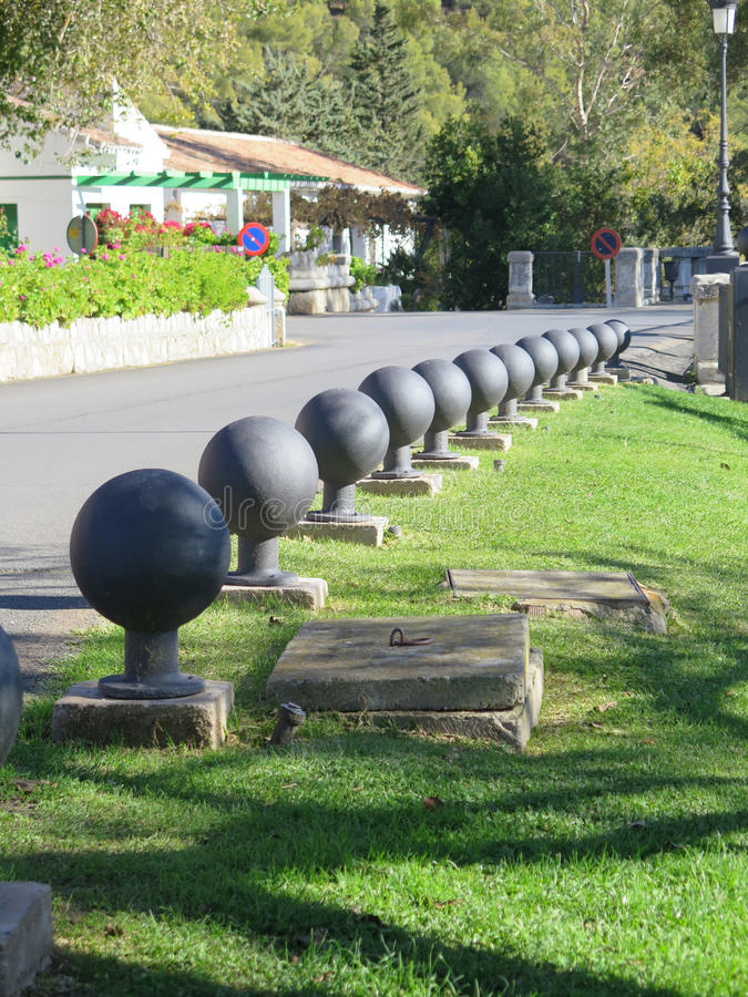 Bollards on grass verge. Metal Bollards lining road on grass verge in Andalusian village royalty free stock photo