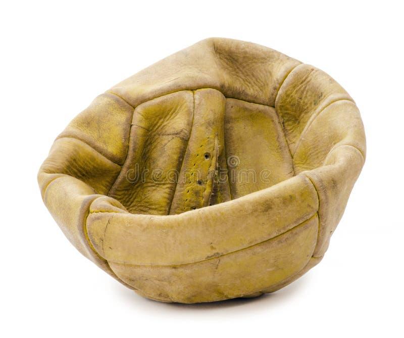 bollen deflaterade gammal fotboll royaltyfri fotografi