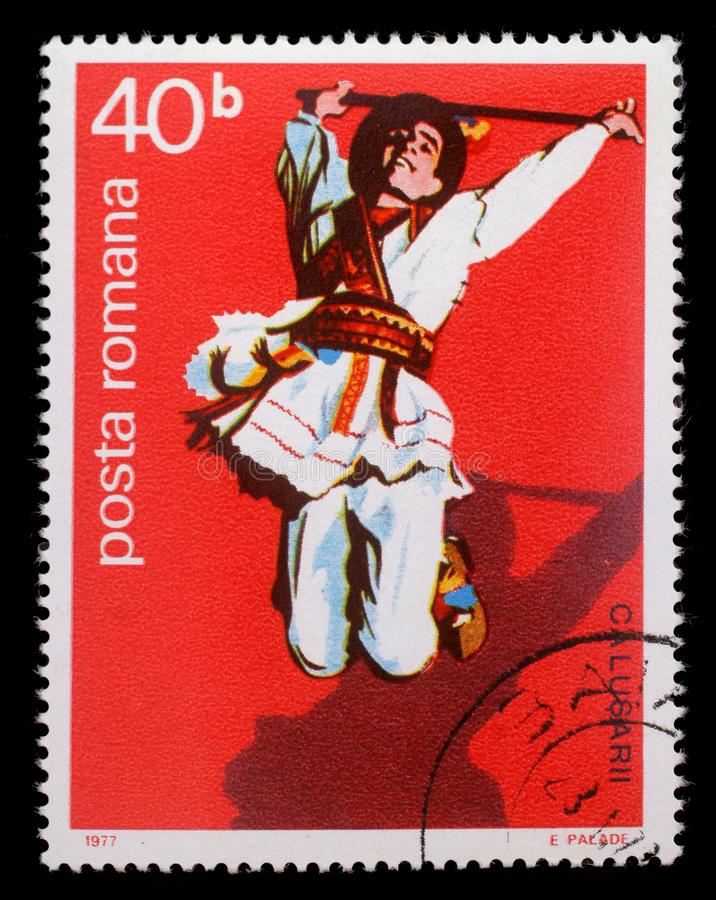 Bollo stampato dalla Romania, ballerino di piega maschio rumeno di manifestazioni fotografia stock libera da diritti