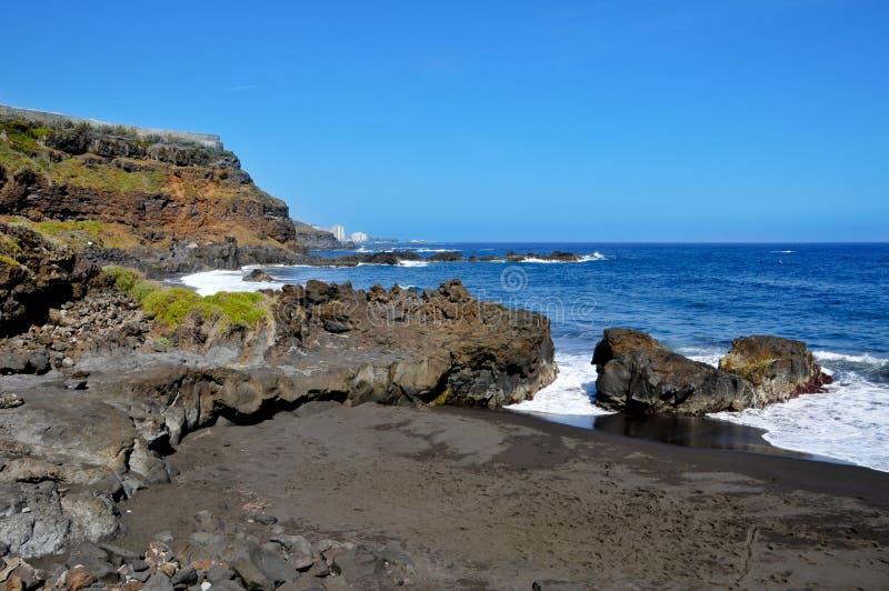 Bollullo Beach in Tenerife, Canary Islands, Spain. A view of volcanic Bollullo Beach in Tenerife, Canary Islands, Spain royalty free stock image