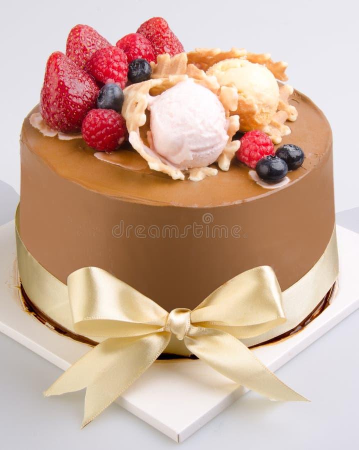 Bolo, bolo de gelado no fundo foto de stock royalty free