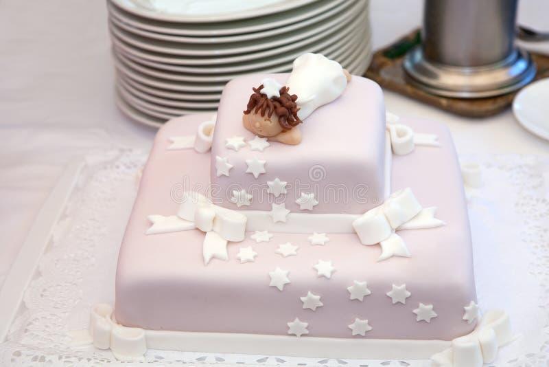 Bolo cor-de-rosa do batismo fotos de stock royalty free
