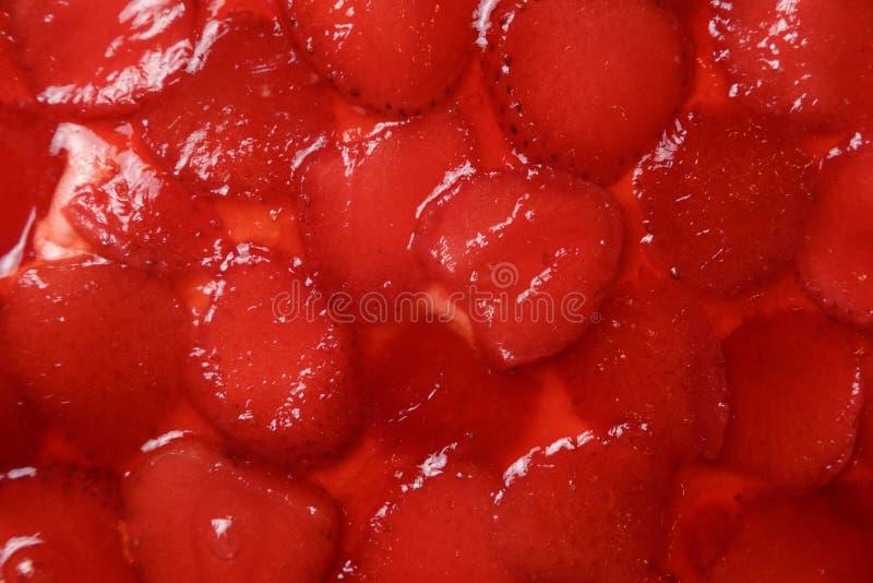 Bolo da geleia da morango Feche acima da textura imagens de stock