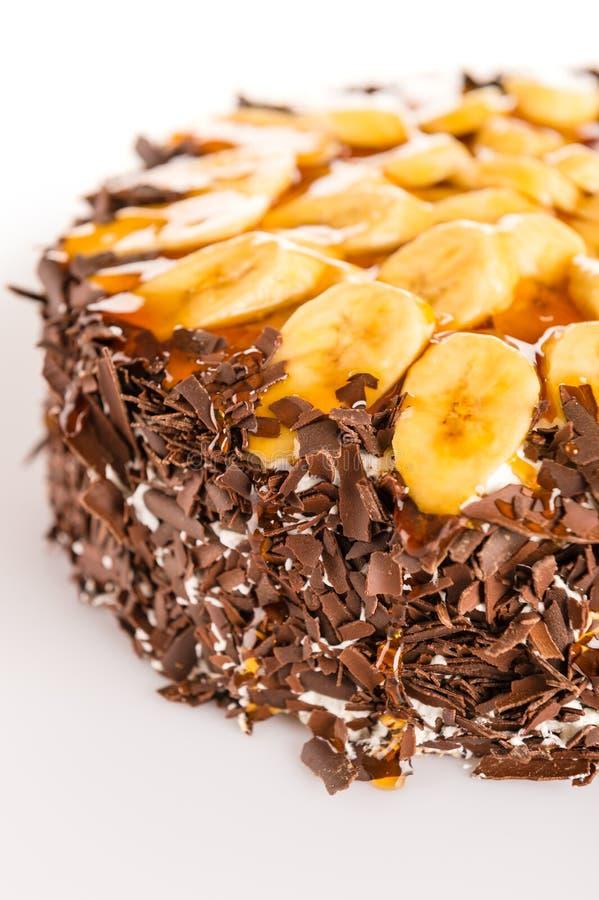 Bolo da sobremesa da banana com cobertura escura do chocolate fotografia de stock royalty free