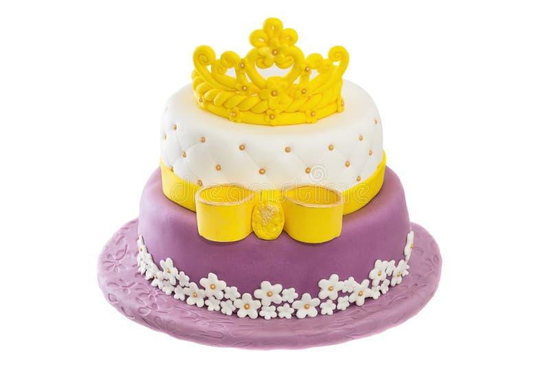 Bolo de aniversário com coroa e curva fotografia de stock
