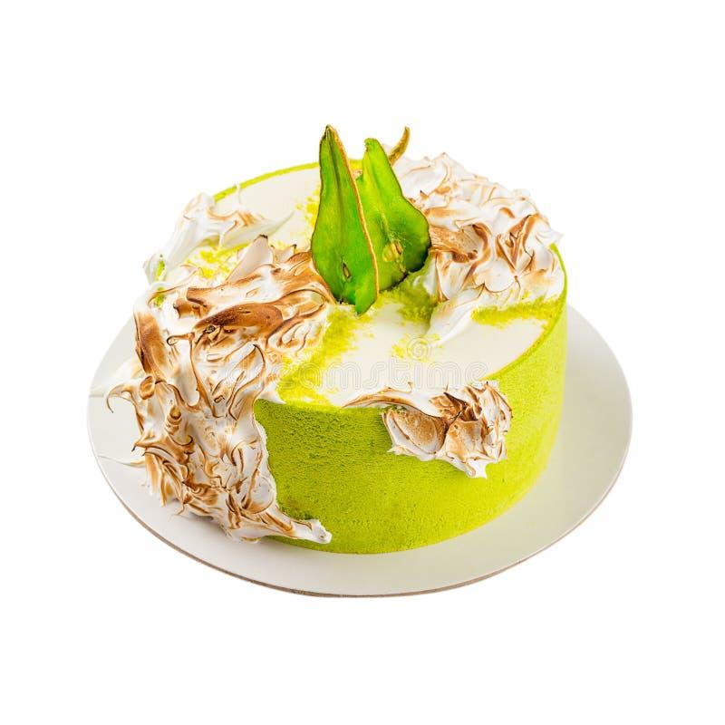 Bolo de aniversário com merengue queimada e fatias coloridas da pera Isolador fotos de stock royalty free