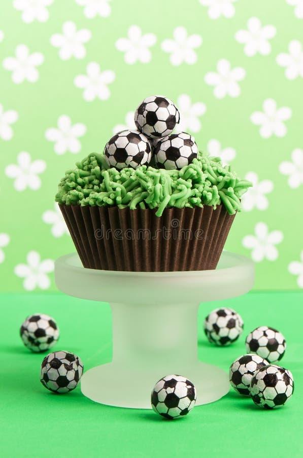 Bolo de aniversário do futebol fotografia de stock
