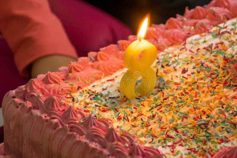 Bolo de aniversário para o oitavo aniversário imagem de stock royalty free