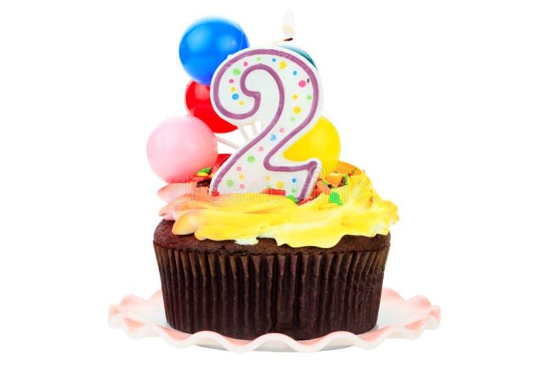 Bolo de aniversário para os anos de idade dois imagem de stock royalty free