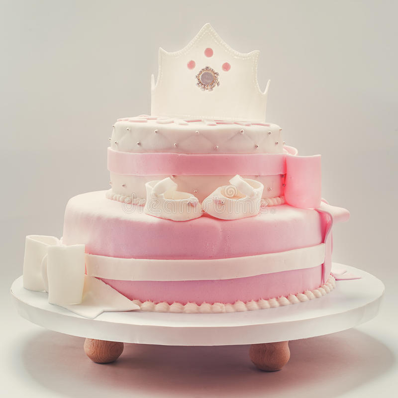 Bolo de aniversário para a rainha do bebê fotografia de stock