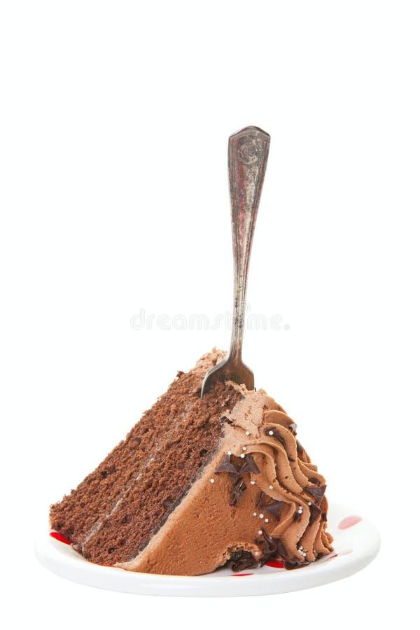 Bolo de camada do chocolate com forquilha fotografia de stock