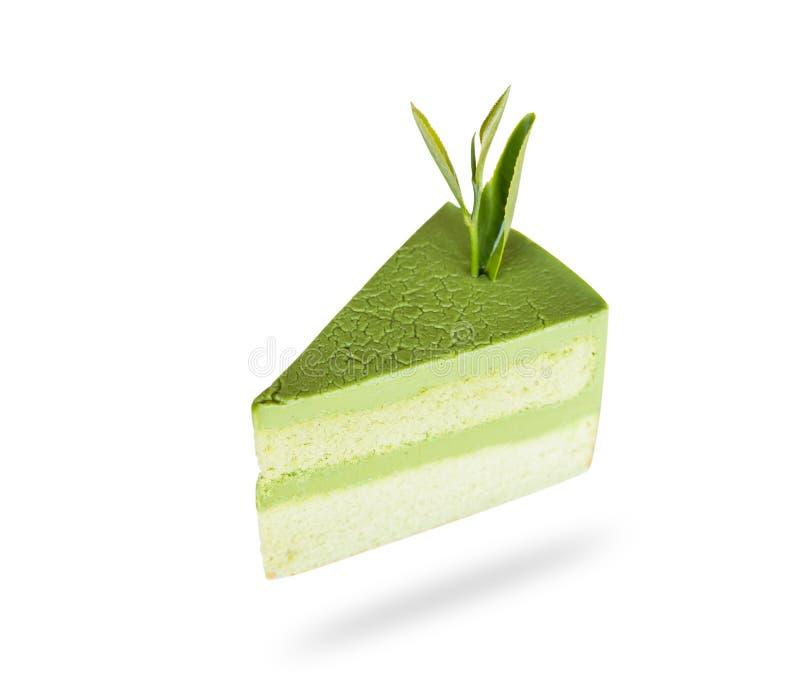 Bolo de esponja do chá verde de Matcha isolado no fundo branco conservado imagens de stock royalty free