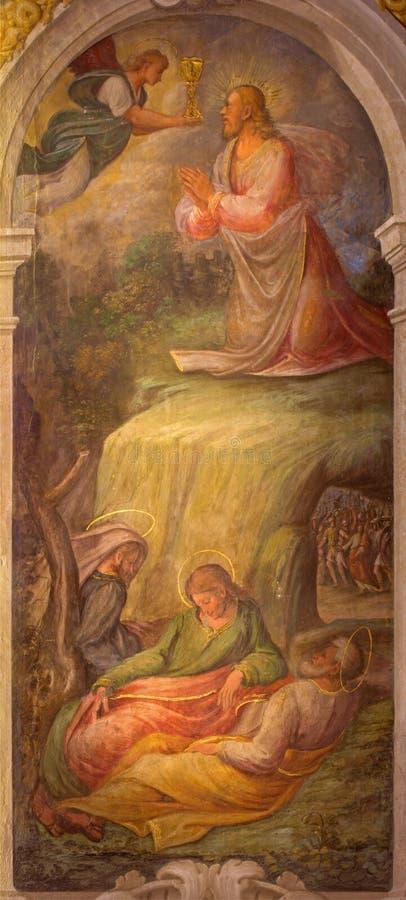 Bologna - freskomålning av bönen av Jesus i den Gethsemane trädgården i barockkyrkan San Michele i Bosco av Bartolomeo Ramenghi arkivfoto