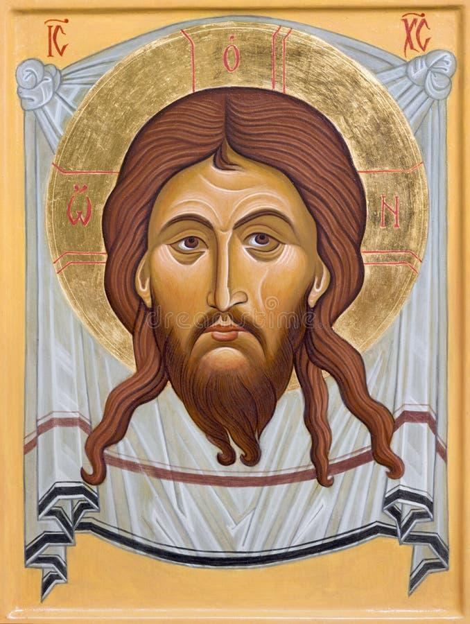 BOLOGNA ITALIEN - APRIL 18, 2018: Symbolen av framsidan av Kristus i kyrkliga Chiesa di San Pietro vid sr Marina Chirico royaltyfria bilder