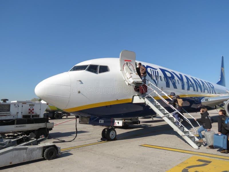 RyanAir Boeing 737-800 boarding in Bologna. BOLOGNA, ITALY - CIRCA APRIL 2018: RyanAir Boeing 737-800 during boarding stock photos