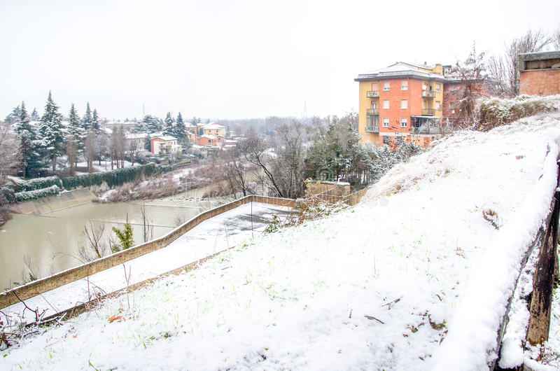 Bologna, Italy, December 28 2014 - view of the river Reno. From the bike path of Casalecchio during a snowfall royalty free stock photos