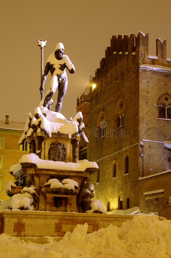 Bologna main square and Neptune fountain after the heavy snowfall of 2012 royalty free stock photo