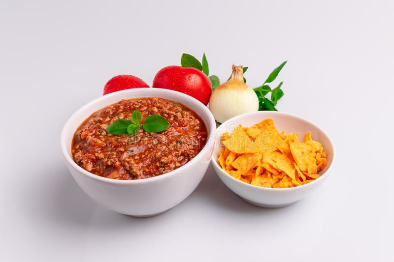 Bolognese also know as Bolognesa or Bolonhesa sauce and corn chips nachos in a white bowl isolated in white background, soft royalty free stock images