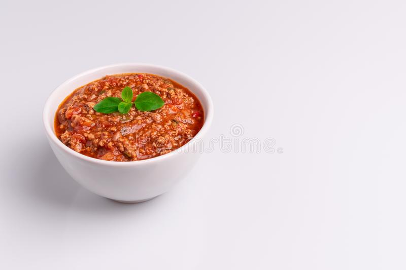 Bolognese also know as Bolognesa or Bolonhesa sauce in a white bowl isolated in white background, soft light, studio photo, copy stock photo