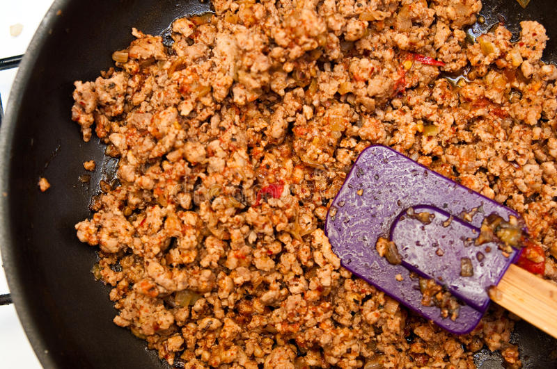Bolognese meat on frying pan stock photo