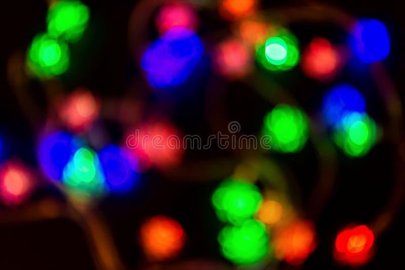 Bolografiskt ljus, färglöst bakgrundsbelysning Helgdagskoncept Begreppet jultid Nyårsbakgrund Partskoncept arkivbild