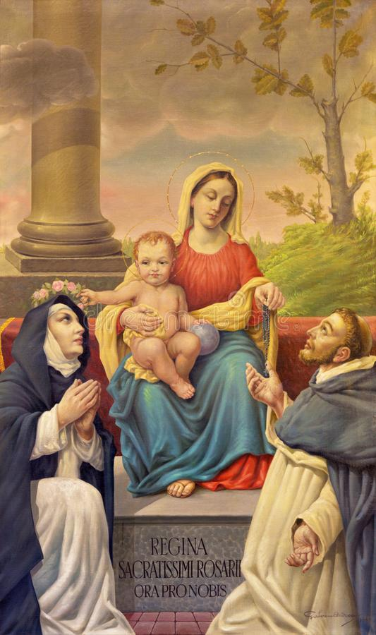 Bolonia - la pintura de Madonna del rosario con St Dominic y St Catherine en el chruch Chiesa di San Benedetto fotos de archivo