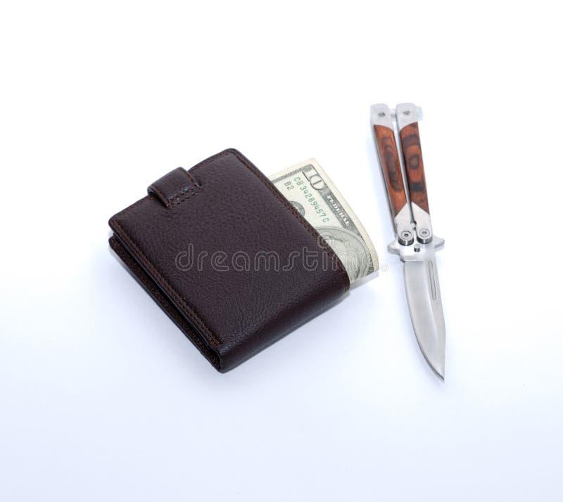 Bolsa & dinheiro & faca imagem de stock