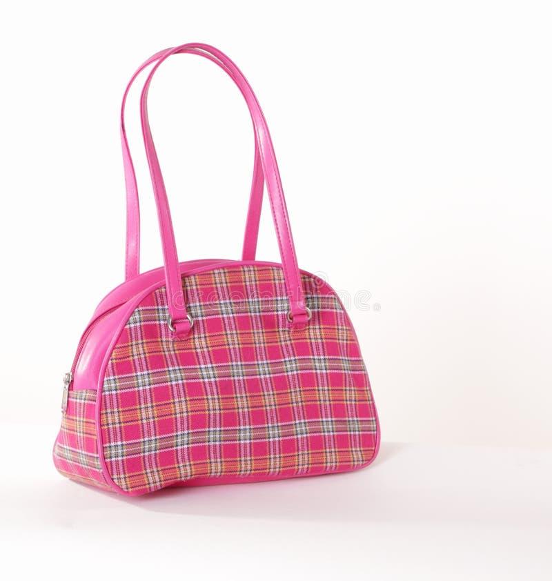 Bolsa checkered cor-de-rosa pequena fotografia de stock