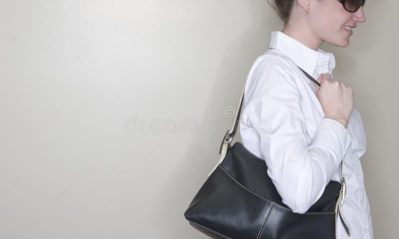 Bolsa da terra arrendada da mulher fotos de stock