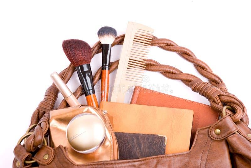 Bolsa das senhoras à moda com cosméticos fotografia de stock