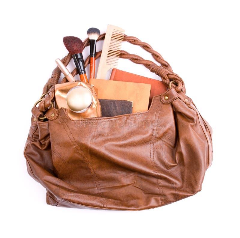 Bolsa das senhoras à moda com cosméticos fotos de stock