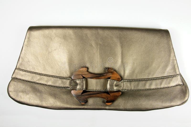 Bolsa de couro fêmea de bronze do desenhador imagem de stock royalty free