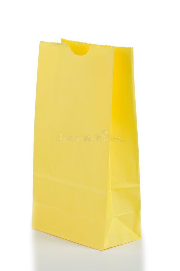 Bolsa de papel amarilla imagenes de archivo
