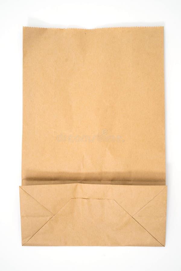 Bolsa de papel de Brown aislada en blanco fotos de archivo libres de regalías