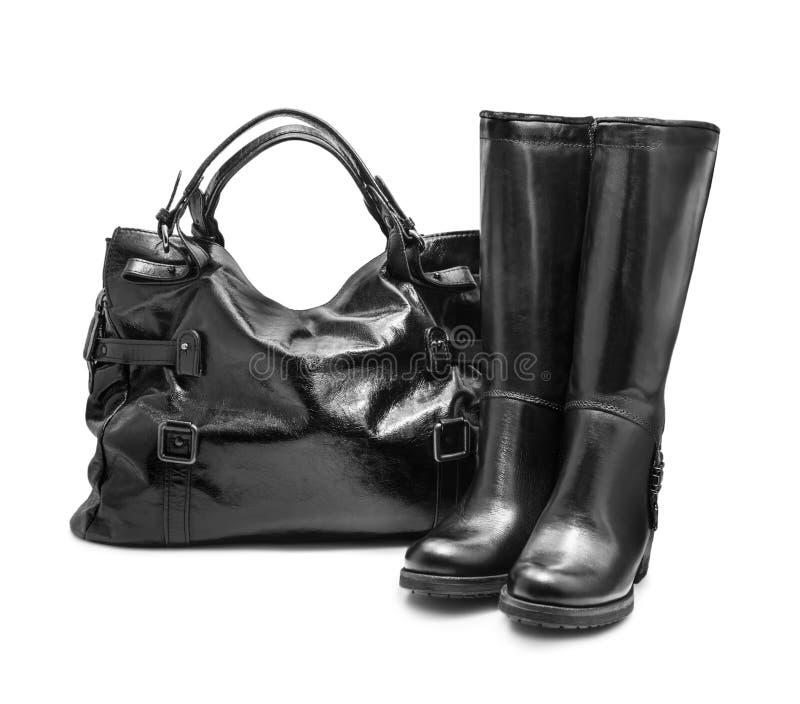 Bolsa e botas foto de stock