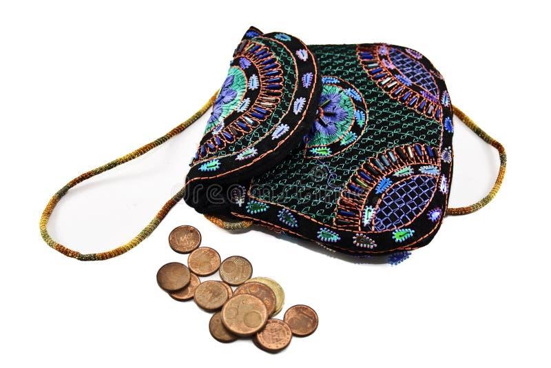 Bolsa e moedas fotos de stock