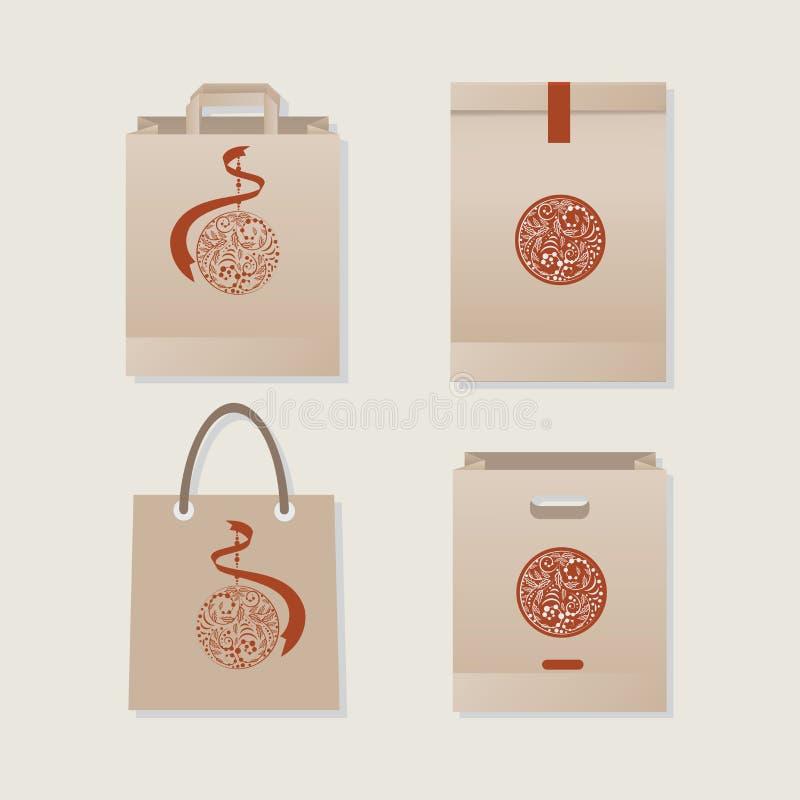 Bolsas de papel y paquetes con un ejemplo de un emblema de la Navidad libre illustration