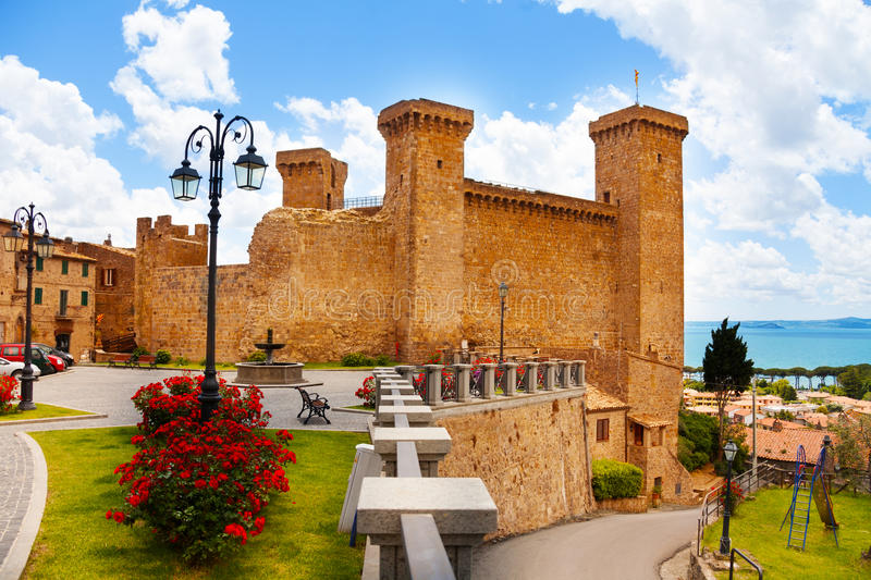 Bolsena billage castle and lake. Bolsena village castle and square in front of it located in Lazio, Itally royalty free stock photography