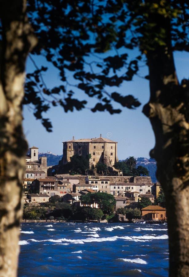 Bolsena, Lazio - Italy. Lake of Bolsena Italy - The medieval town with castle on Lake Bolsena, region Latium, central Italy. On background the medieval village stock photo
