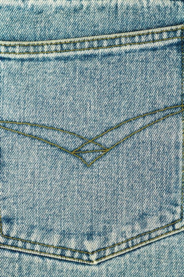 Bolsillo trasero de tejanos, fondo de la textura del dril de algodón imagen de archivo libre de regalías