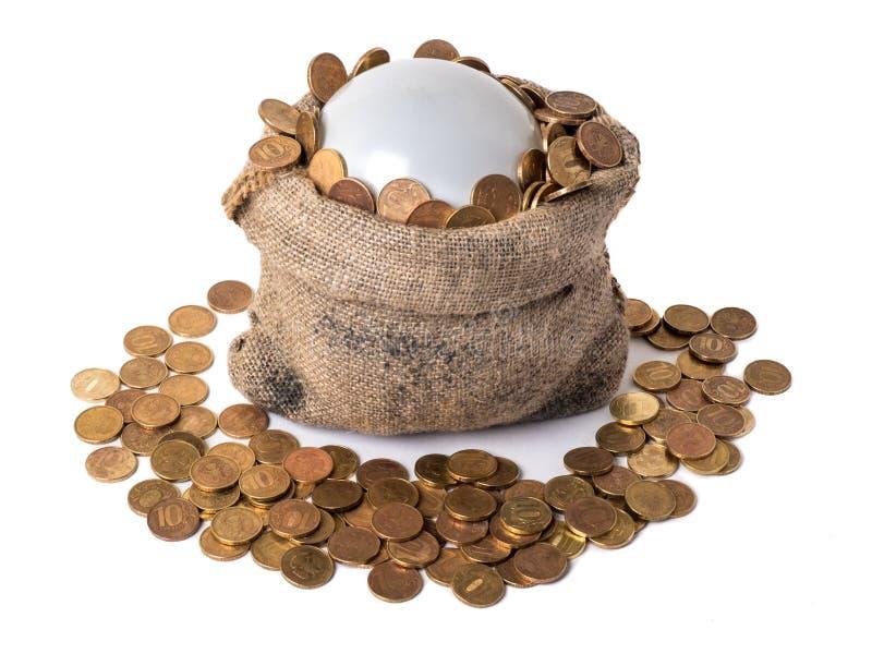 Bolso con la burbuja y las monedas foto de archivo