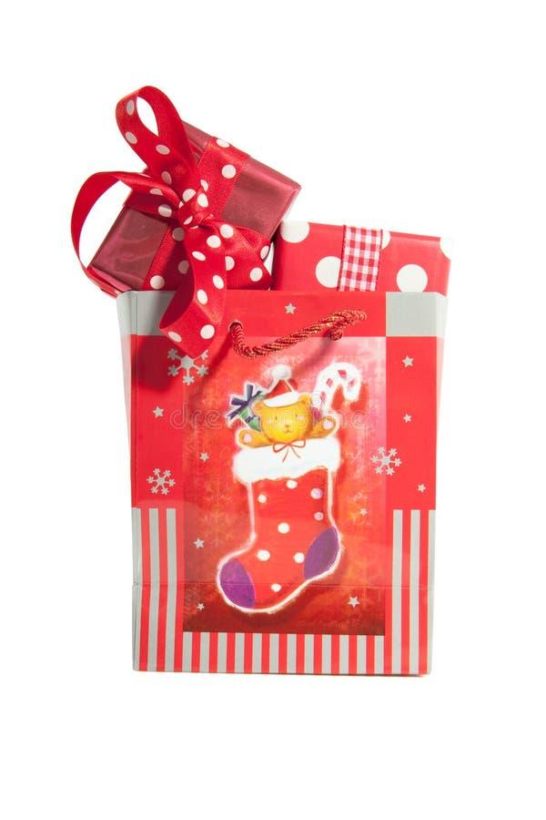 Bolso con los regalos de la Navidad imágenes de archivo libres de regalías