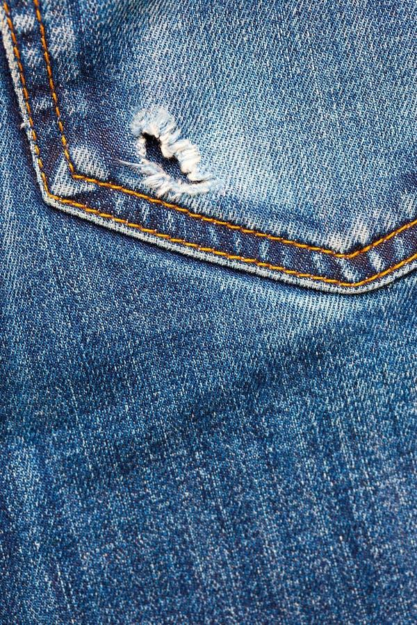 Bolso das calças de brim com furo fotos de stock