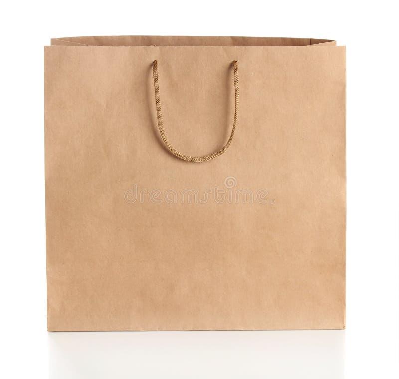 Bolso de compras de papel con las manijas fotografía de archivo